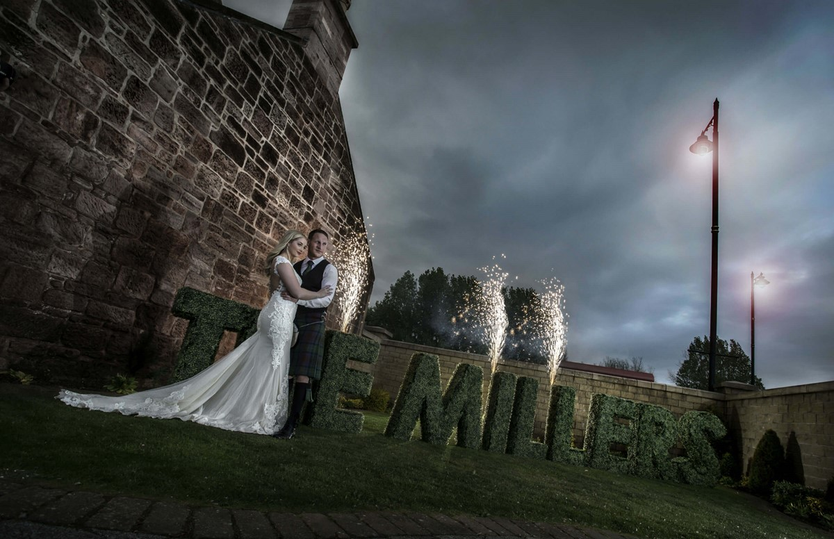 Couple embracing after getting married at Dumfries Arms Hotel